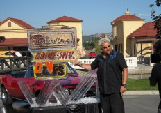 Guy Fieri with Diners Drive In's and Dives ice sculpture